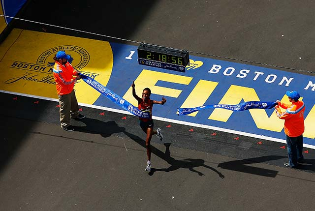 Rita Jeptoo crosses the finish line. (Getty)