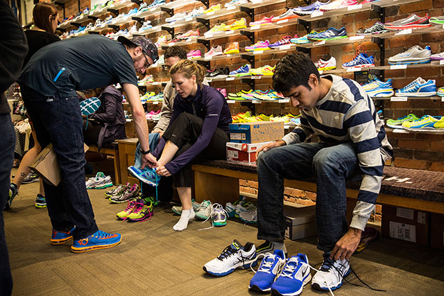 People shop for running shoes Sunday, April 3 inside Marathon Sports. One of the bombs at last year's marathon went off directly in front of the store (Getty)