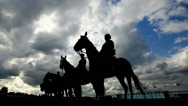 Authorities stand at attention before the 145th running of the Belmont Stakes. (Getty)