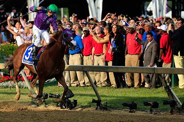 Victor Espinoza celebrates atop California Chrome #3 after winning the 139th running of the Preakness Stakes. (Photo by Patrick Smith/Getty Images)