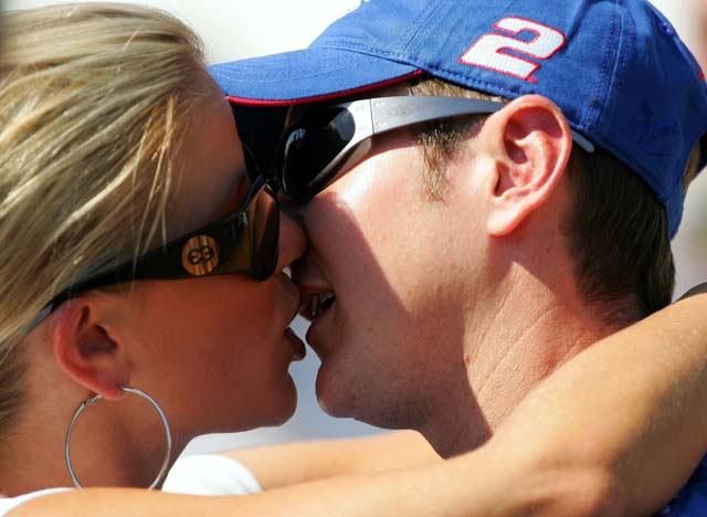 Kurt Busch shares a kiss with his now ex-wife, Eva Bryan, before they were separated in 2011. (Getty)