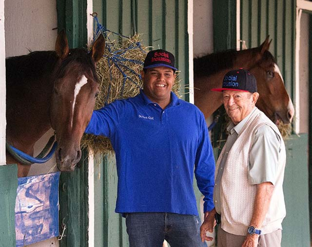 Owner Ron Sanchez (left) and trainer Manny Azpurua (right) get Social Inclusion ready for The Preakness 2014.