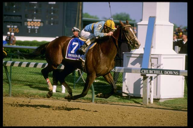 """Unbridled crosses the finish line ahead of the pack at the 1990's  """"Run for the Roses."""" (Getty)"""