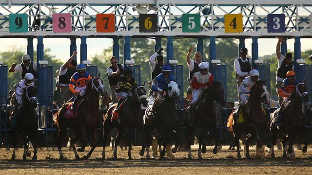 The horses take off at the 145th running of the Belmont Stakes. (Getty)