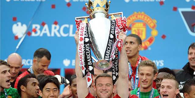 (Rooney holds Premier League trophy, 2013 / Getty)