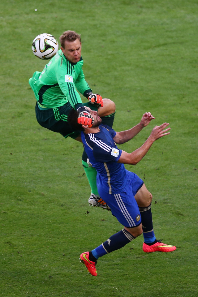 Manuel Neuer of Germany collides with Gonzalo Higuain