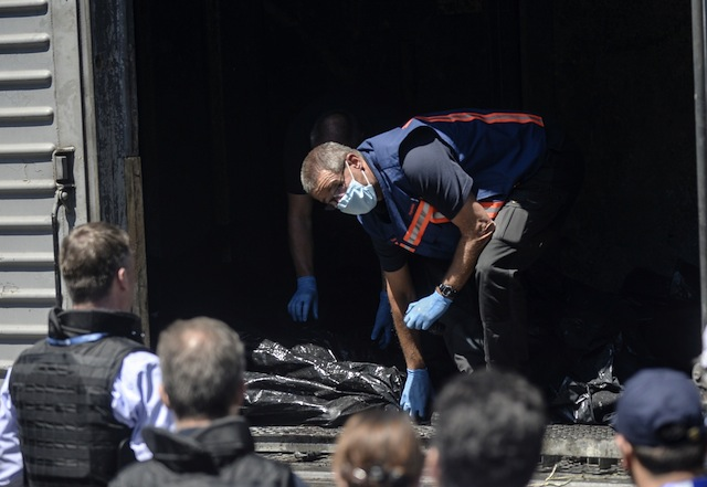 MH17 victims bodies, Malaysian Airlines plane shot down, Russian separatists, Torez, Ukraine