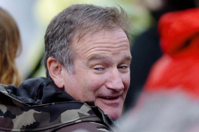 US actor Robin Williams smiles as he arr