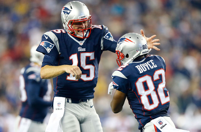 Mallett celebrates with Josh Boyce after connecting for a touchdown pass during a 2013 preseason game against the Giants. (Getty)