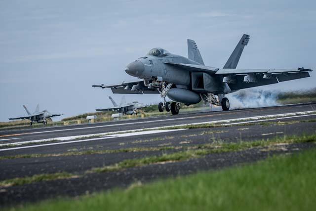 U.S. Navy Conduct Field Carrier Landing Practice In Iwo Jima