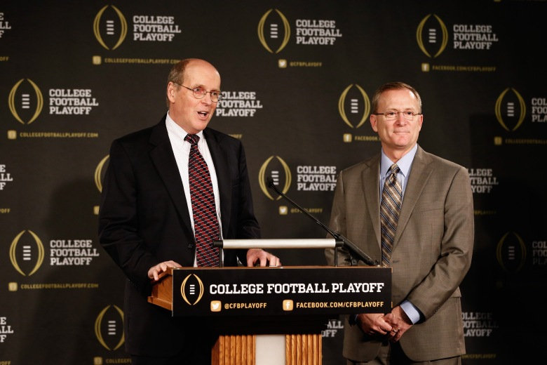 From left: Bill Hancock, executive director of the College Football Playoff, and Jeff Long as the chairman the committee that will select four teams to compete in the first playoff at the end of the 2014 season.  (Getty)