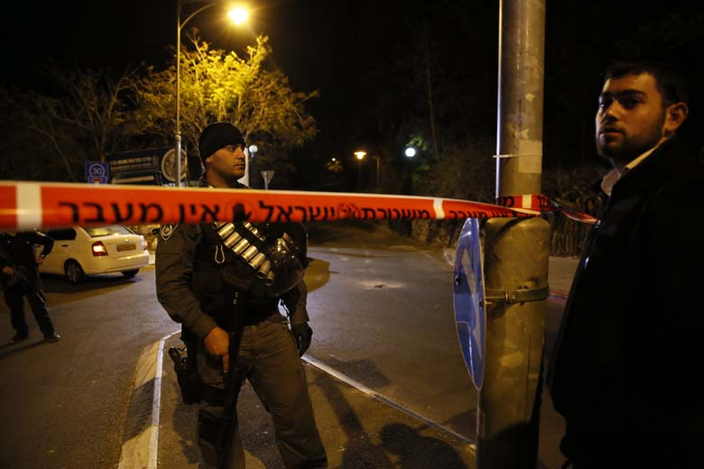 A member of the IDF securing the area around where Glick was shot. (Getty)