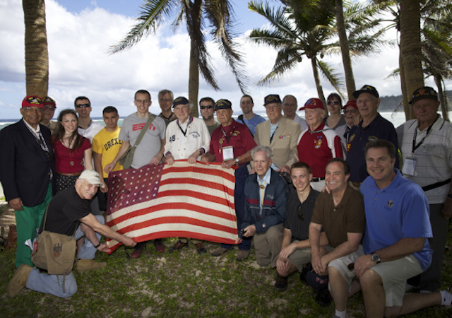 (handout - Rep. Braley and group of Iwo Jima veterans and Ohio State University students https://www.flickr.com/photos/repbraley/6987929909/)