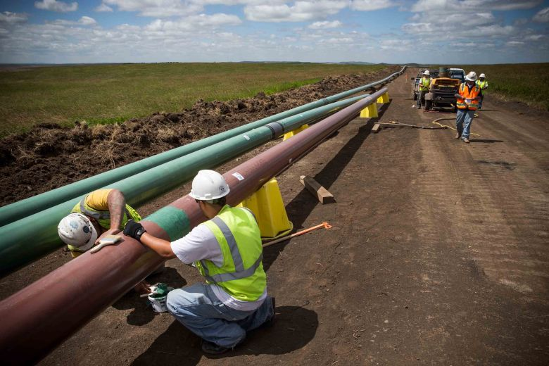 Construction workers pipe-laying in North Dakota. (Getty)