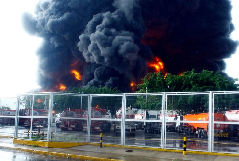 A Venezuelan refinery in Guaraguao,  220 km east of Caracas, after a fire broke when a lightning struck a treatment pond. (Getty)