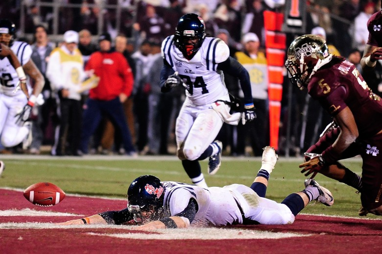 Ole Miss' Bo Wallace fumbles into the end zone in last year's Egg Bowl, won by Mississippi State. (Getty)