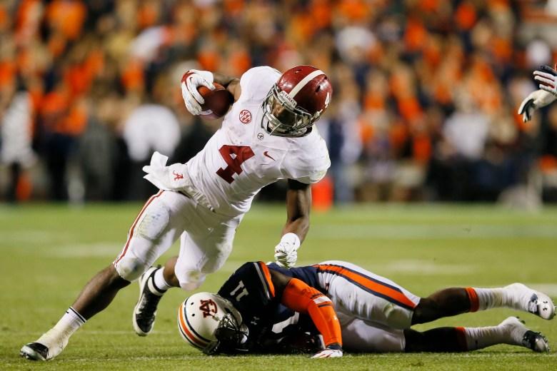 Alabama's T.J. Yeldon tries to avoid a Chris Davis tackle in last season's Iron Bowl. (Getty)