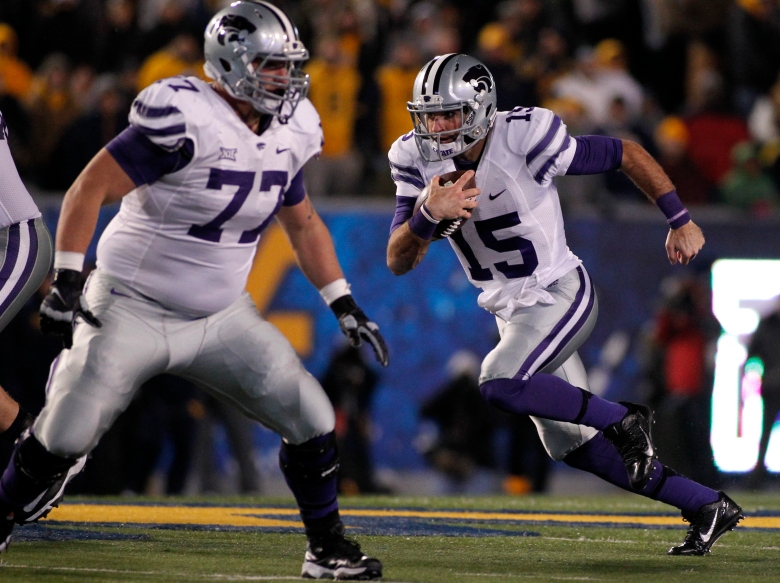 Kansas State quarterback Jake Waters runs the ball during Thursday night's 26-20 win over West Virginia. (Getty)