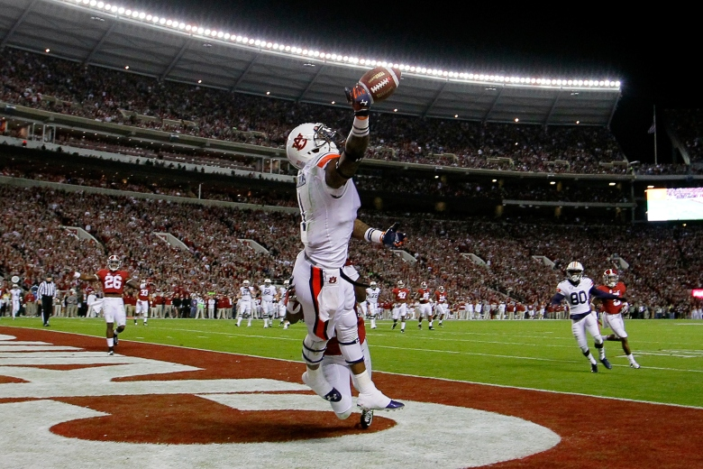 Duke Williams can't come up with a catch during Saturday night's Iron Bowl. (Getty)