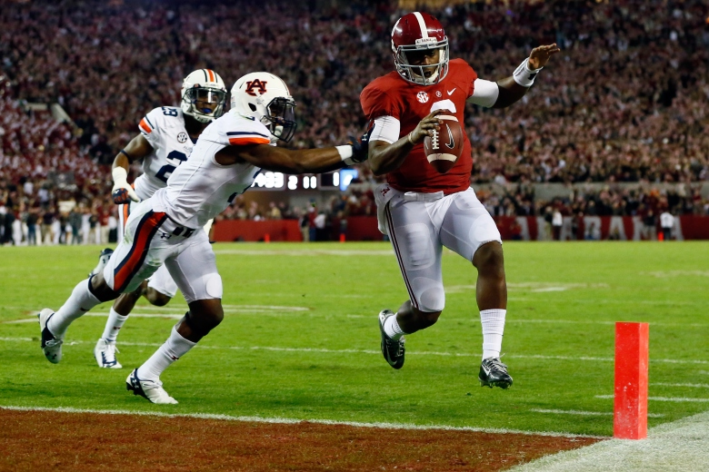 Blake Sims scores a rushing touchdown in Saturday's Iron Bowl. (Getty)
