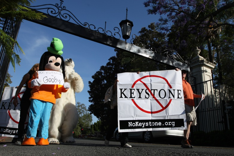 Activists opposed to the Keystone XL Canada-to-Texas pipeline project rally outside a USC Shoah Foundation fundraiser to be attended by President Barack Obama. (Getty)