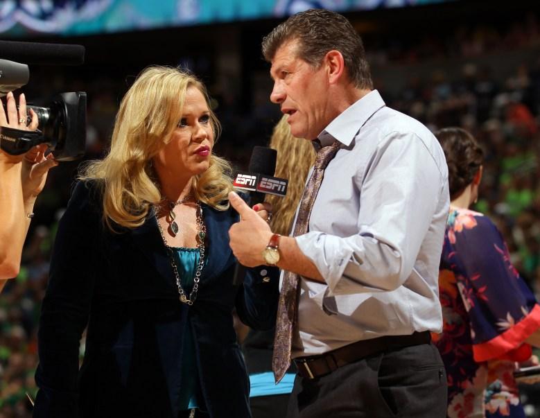 Rowe with UConn women's basketball coach Geno Auriemma. (Getty)