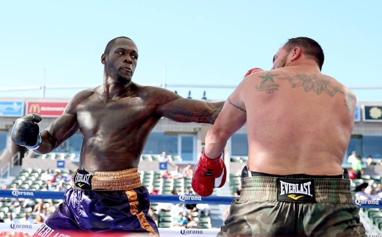 Deontay Wilder (L)  punches  Jason Gavern  (Photo by Stephen Dunn/Getty Images)