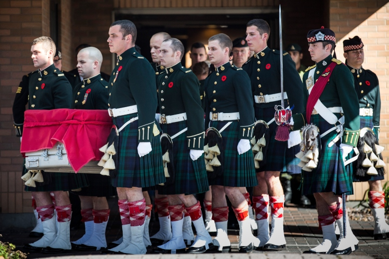 Canadian Army soldiers carry the casket carrying Cpl. Nathan Cirillo, two days after he was shot dead by a gunman while he guarded the National War Memorial. The gunman then stormed the main parliament building before he was shot dead. (Getty)