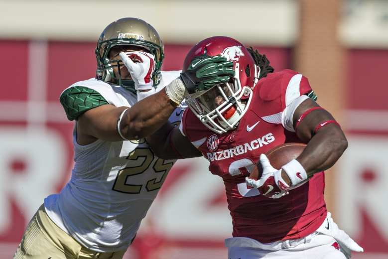 Alex Collins was one of two Arkansas running backs to run for 1,000 yards. Jonathan Collins was the other. (Getty)