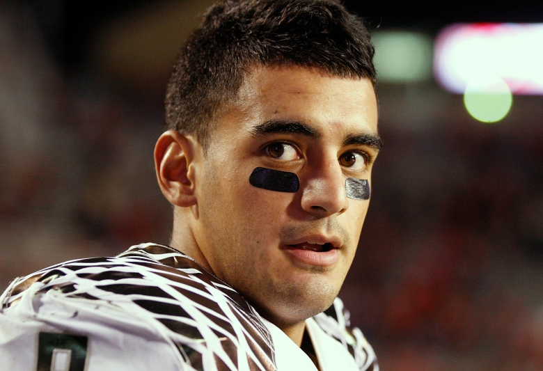 Quarterback Marcus Mariota is looking to become the first Oregon player to win the Heisman Trophy. (Getty)