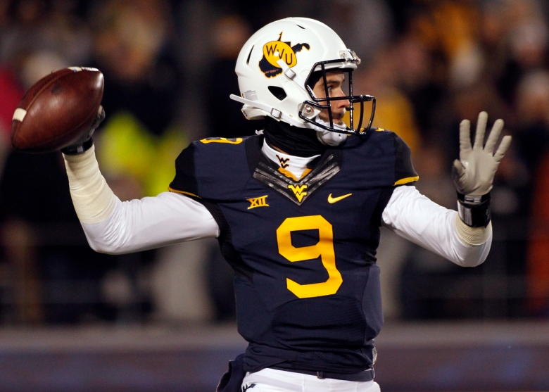 West Virginia quarterback Clint Trickett has retired after suffering 5 concussions over the past 14 months. (Getty)