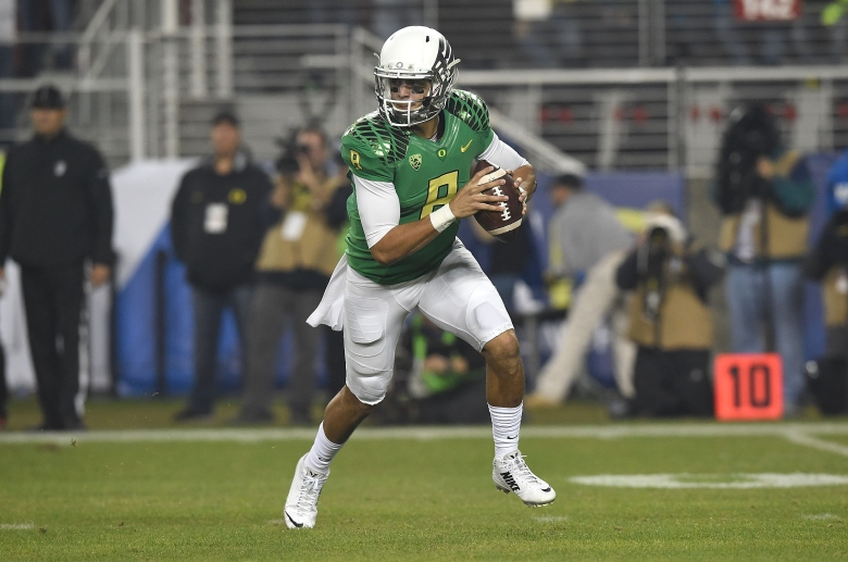 Heisman Trophy winner Marcus Mariota is the first Oregon quarterback to be named to the AP All-America Team. (Getty)