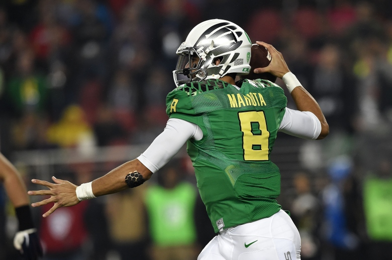Oregon quarterback Marcus Mariota became the 80th winner of the Heisman Trophy Saturday night. (Getty)