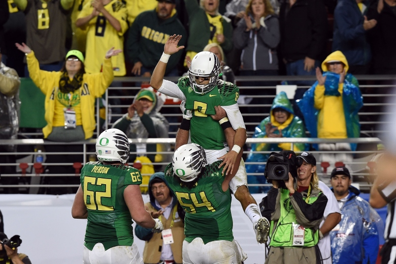 Heisman winner Marcus Mariota and the Oregon Ducks hope to rise to the occasion in their College Football Playoff semifinal against Florida State. (Getty)