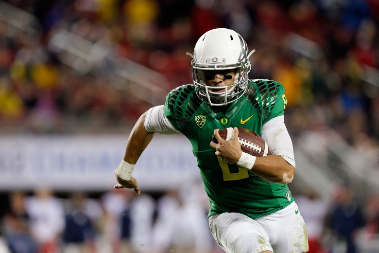 Oregon quarterback Marcus Mariota was named the 80th winner of the Heisman Trophy on Saturday night. (Getty)