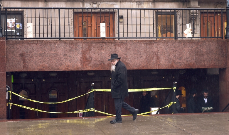 A man passes the Chabad Lubavitch World Headquarters in Brooklyn December 9, 2014 in New York. (Getty)