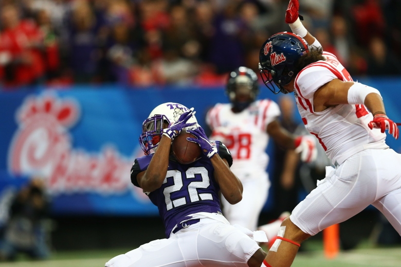 Aaron Green catches a 31-yard touchdown during TCU's Peach Bowl game against Ole Miss. (Getty)