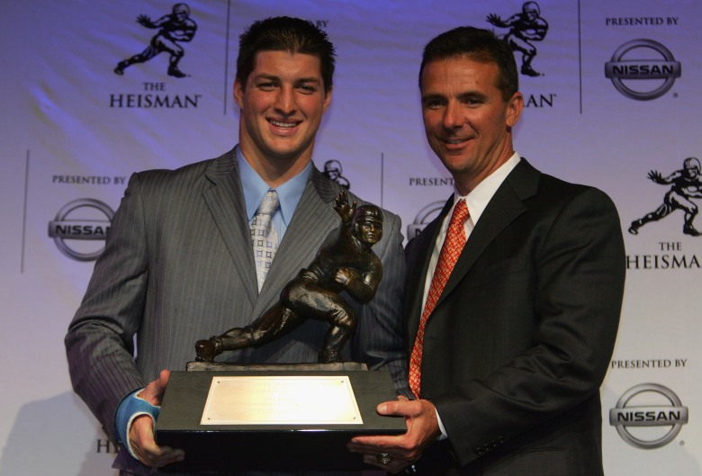 2007 winner Tim Tebow of Florida and then-coach Urban Meyer. (Getty)