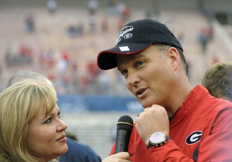 Holly Rowe with Georgia coach Mark Richt in 2009. (Getty)