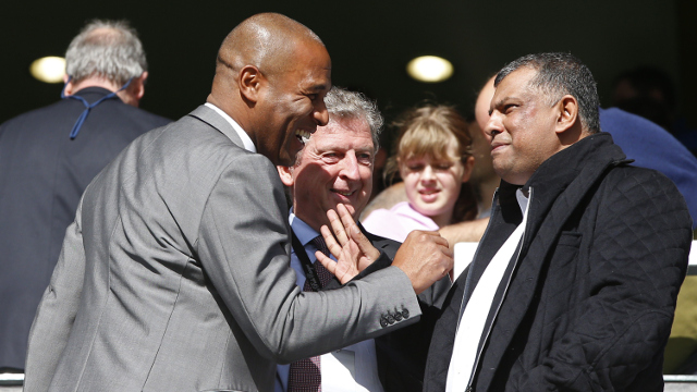 Queens Park Rangers' English head of football operations Les Ferdinand (L) speaks with Queens Park Rangers' Malaysian owner Tony Fernandes (R) and England football manager Roy Hodgson (C)  in London on October 19, 2014. (Getty)