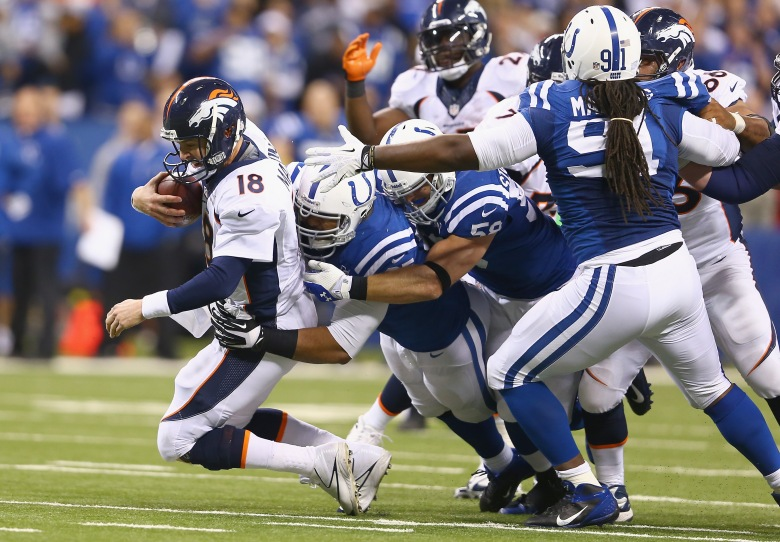 Peyton Manning #18 of the Denver Broncos is sacked during the game against the Indianapolis Colts at Lucas Oil Stadium on October 20, 2013 in Indianapolis, Indiana. (Getty)