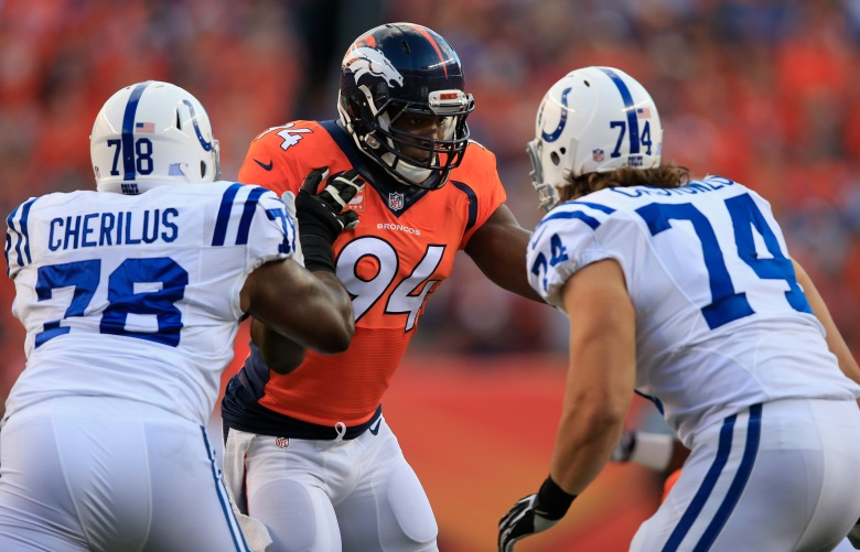 Defensive end DeMarcus Ware #94 of the Denver Broncos rushes the line of scrimmage against tackle Gosder Cherilus #78 and tackle Anthony Castonzo #74 of the Indianapolis Colts at Sports Authority Field at Mile High on September 7, 2014 in Denver, Colorado. (Getty)