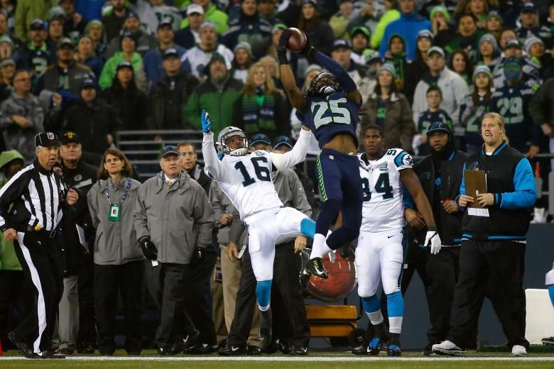 Richard Sherman made an incredible play to intercept Cam Newton. (Getty)