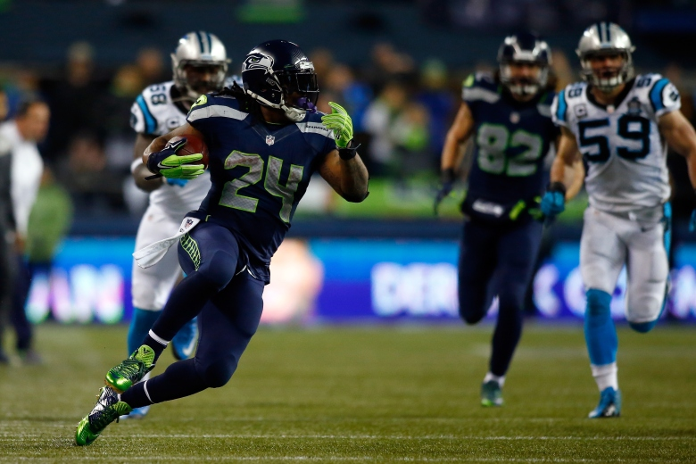 Marshawn Lynch and the Seahawks host the Packers in Sunday's NFC Championship Game. (Getty)