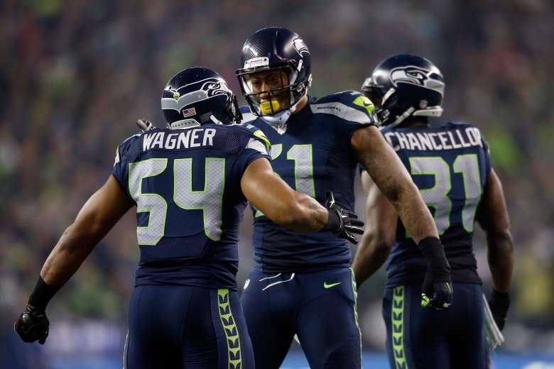Seahawks defenders celebrate a touchdown in their win over the Panthers. (Getty)