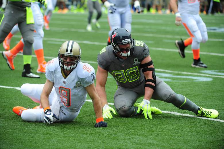 Saints QB Drew Brees, left, and J.J. Watt of the Texans in last year's Pro Bowl. (Getty)