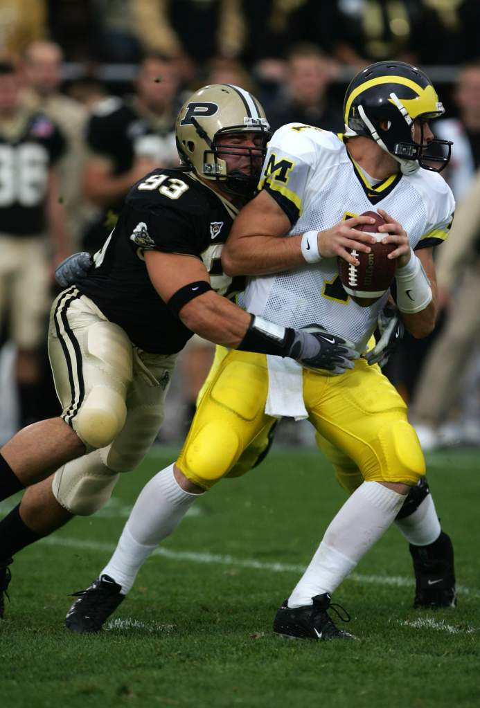 Ninkovich, then of Purdue, sacks Michigan quarterback Chad Henne in a 2004 game. (Getty)