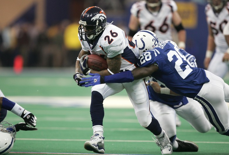 Tatum Bell #26 of the Denver Broncos tries to get free of Idrees Bashir #28 of the Indianapolis Colts during the AFC Wildcard playoff game at the RCA Dome on January 9, 2005 in Indianapolis, Indiana. (Getty)