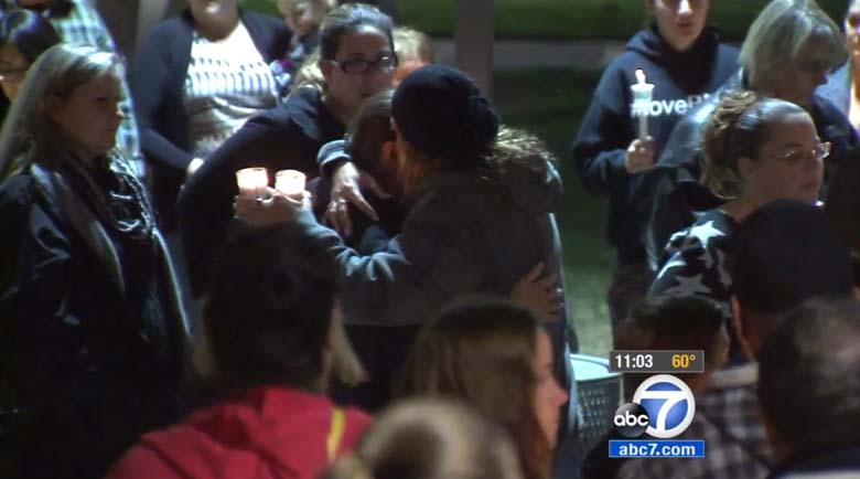 Mourners embrace at a vigil for Ellorah. (Screengrab via ABC Los Angeles)