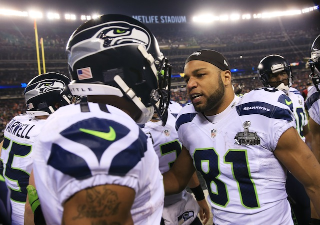 Harvin and Tate interact after the 2013 Superbowl win. (Getty)
